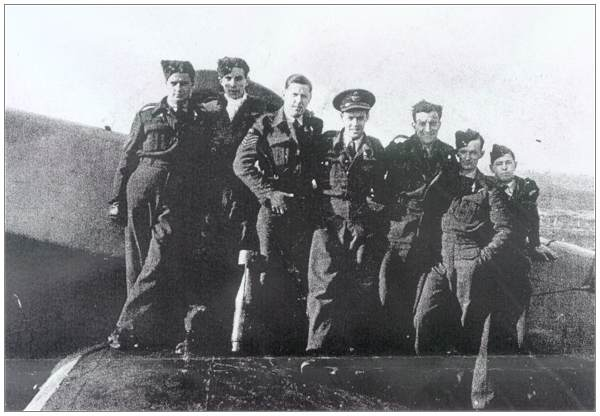 Crew Beattie - standing on wing of Halifax - RCAF