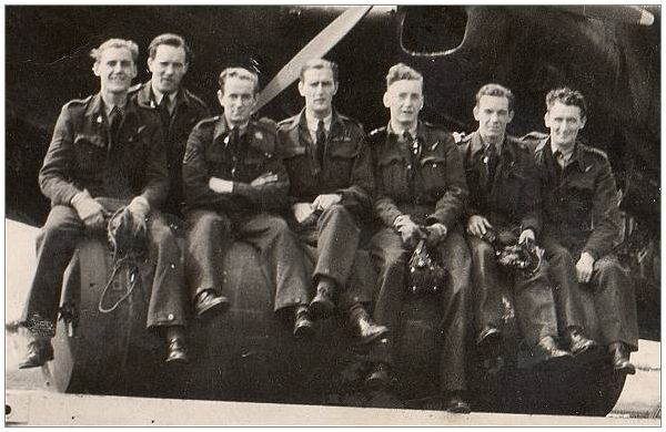 Shorter (F), Race (A), Sloan (A), Rule (P), Manley (S), Reeves (N) and Coyne (W) in front of Lancaster K2 - likely summer 1943