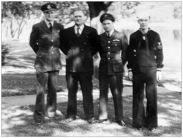 Douglas with his dad John and brothers Earl and Sydney, 1945