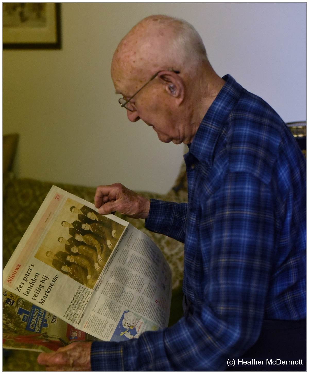 Everett (98) with newspaper