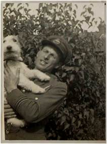Navigator F/Lt. George Newsham - DFC - with his dog 'Joe'