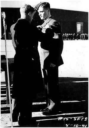 Duke of Windsor pins up Charlie's pilot badge