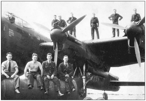 Sgt. John Johnstone Sloan - 3rd Right - on wing - likely summer 1943, Elsham Wolds