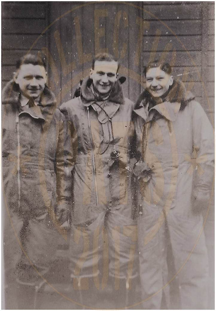 Sgt. Kenneth Forster (middle) - with buddies - location unknown